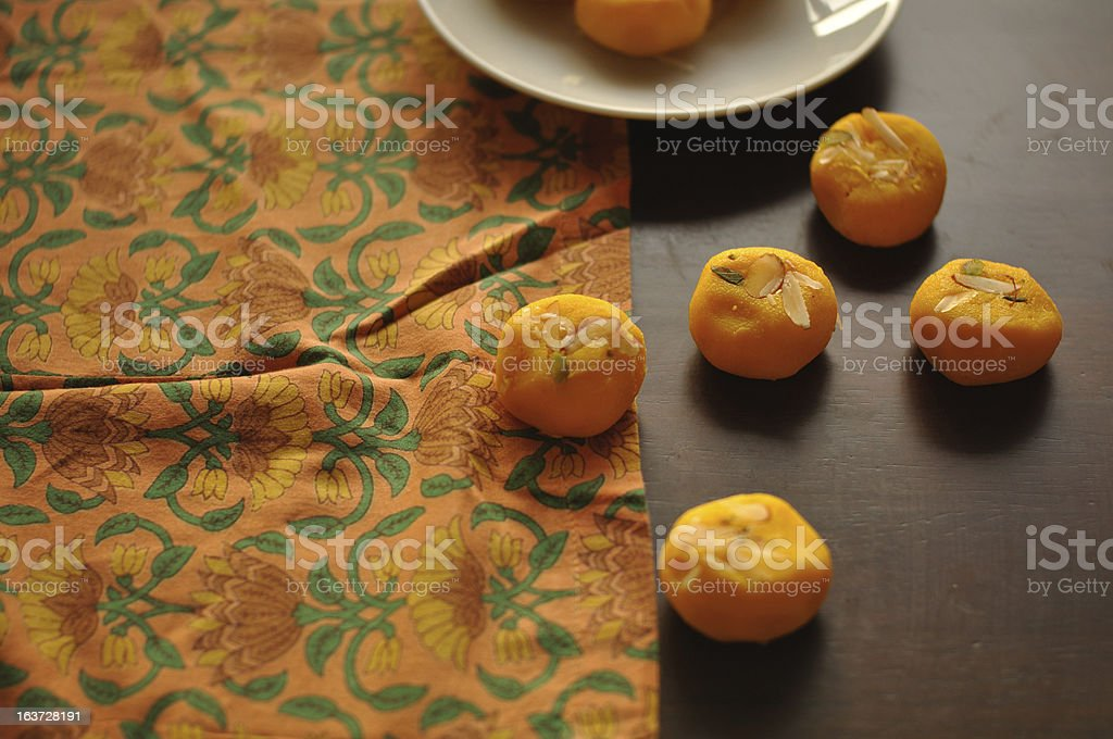 Indian Sweets spread over a traditional printed cloth royalty-free stock photo