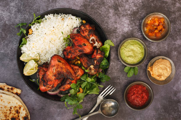 indian tandoori chicken wings and sauces - chicken rice stock photos and pictures