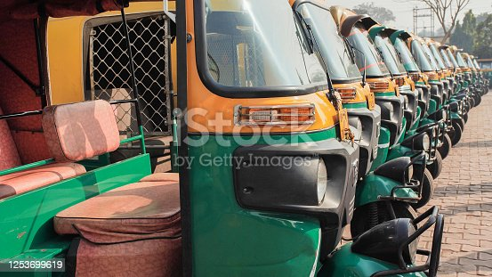 Indian taxi rickshaws exposed in a row