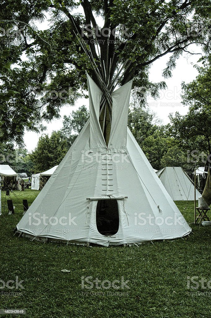 Indian tee pee at a primative gathering. stock photo