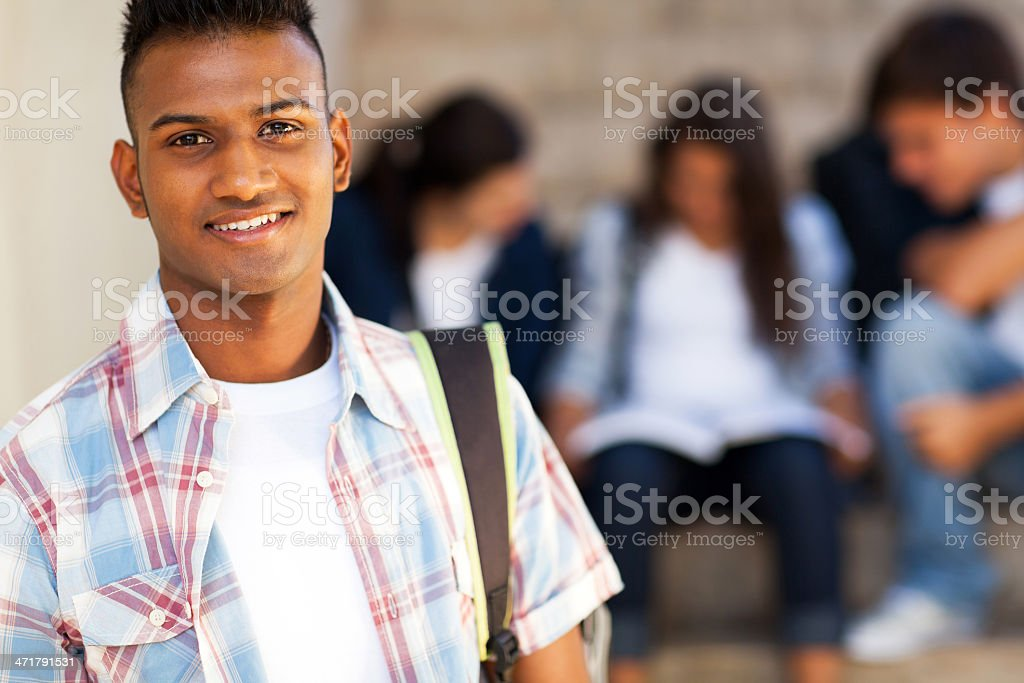 indian teenage student carrying schoolbag royalty-free stock photo