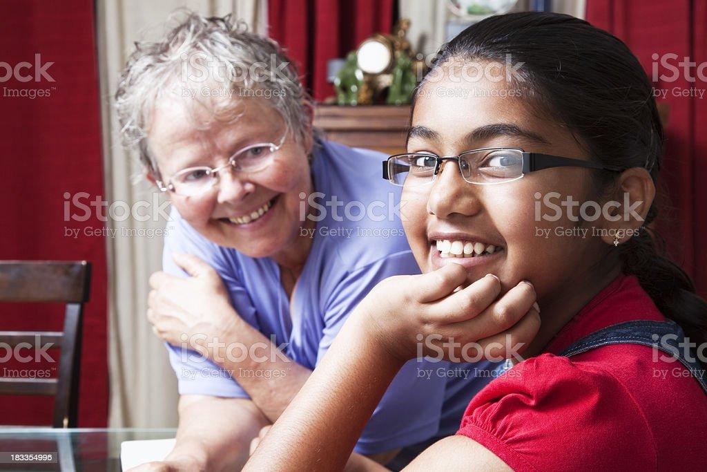indian teenager and caucasioan senior woman royalty-free stock photo