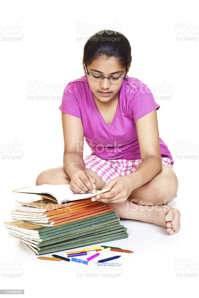 Indian Teenager Girl Student Studying with her School Books royalty-free stock photo
