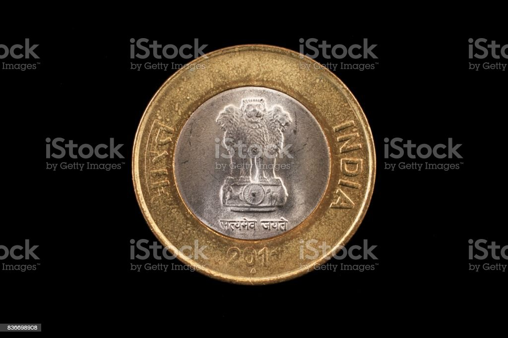 Indian ten rupee coin close up on black stock photo