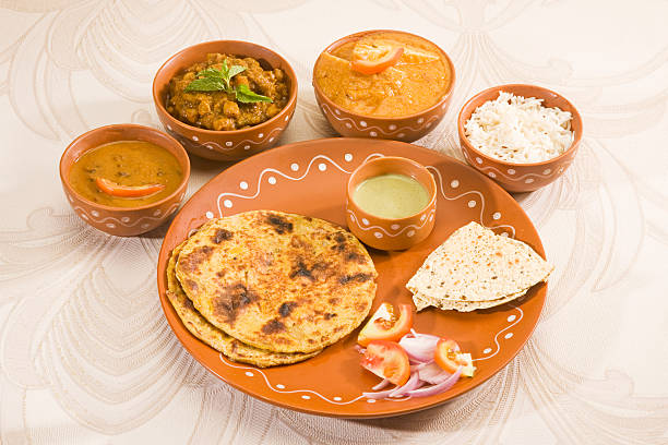 Indian Thali Indian Thali with Paratha dal makhani stock pictures, royalty-free photos & images