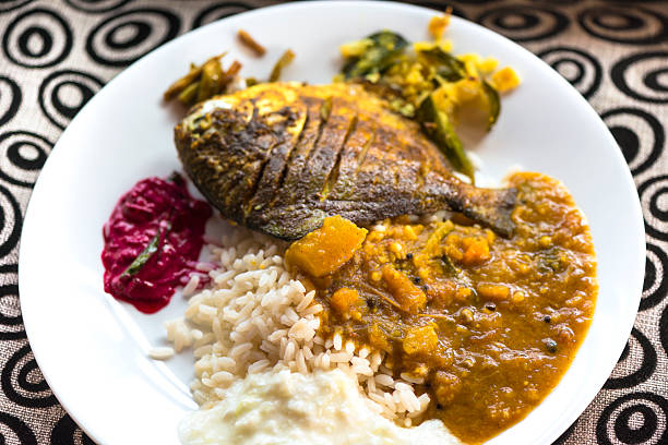 Indian Thali with fish A plat of south Indian thali - simple traditional meal with rice, vegetable, fish on plate. dal makhani stock pictures, royalty-free photos & images