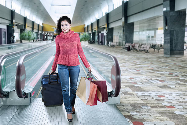 Indian tourist walking in the airport hall stock photo
