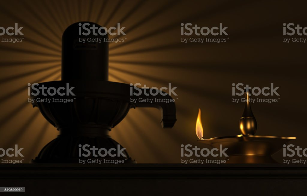 Indian Traditional Oil Lamp with siva lingam stock photo