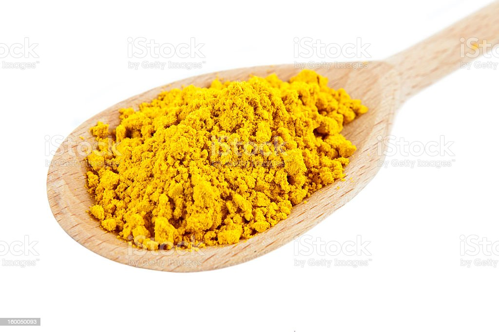 Indian Turmeric spice on wooden spoon royalty-free stock photo
