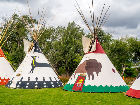 Edmonton, Alberta, Canada - July 1st, 2018: People visiting an authentic Tee-pee from Native North Americans, enjoying Canada Day