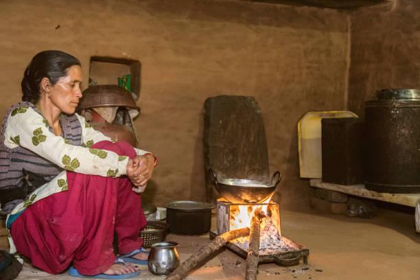 Indian village woman preparing food stock photo