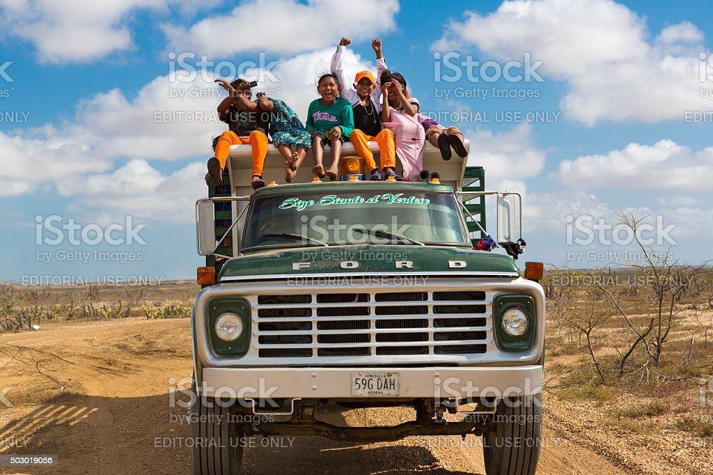 Indian Wayuu traveling on a truck in La Guajira, Colombia stock photo