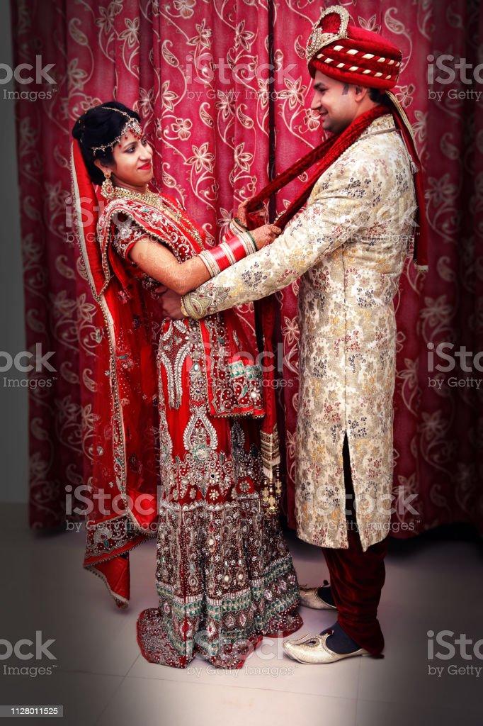 Indian Wedding Couple Posing Stock Photo Download Image Now Istock