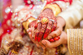istock Indian wedding hands 866987662