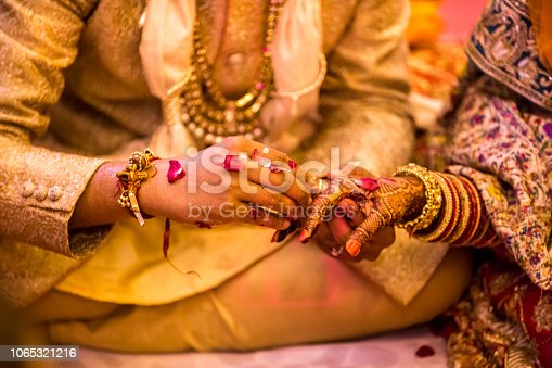 Indian wedding ring  ceremony.hands of the bride held by a groom during a traditional ritual in an Indian Hindu Wedding