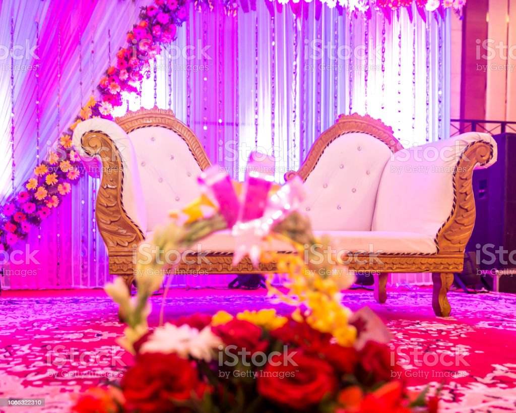 Indian Wedding Stage Decorations With Colorful Flowers Stock Photo -  Download Image Now - iStock