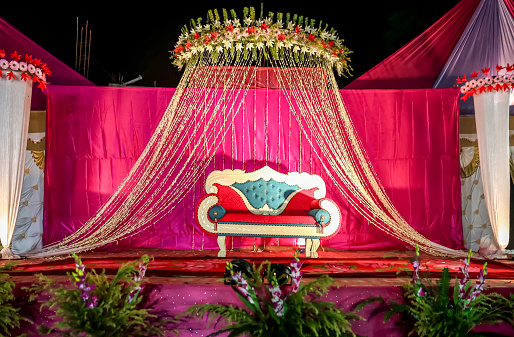 Indian Wedding Stage Decorations With Colorful Flowers Stock Photo
