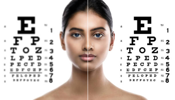 Indian woman and eye chart for sight test stock photo