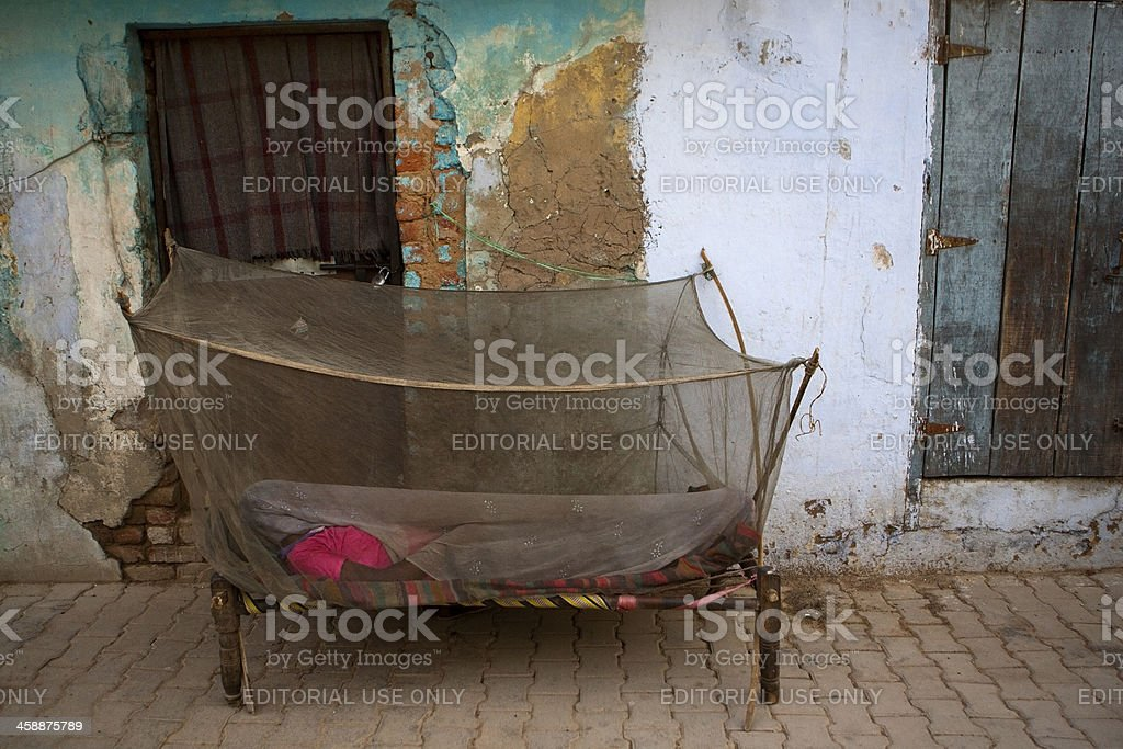 Indian woman and mosquito net stock photo