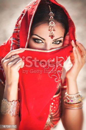 istock Indian woman bellydancer in traditional sari. Oriental Bride. Beauty 167081752