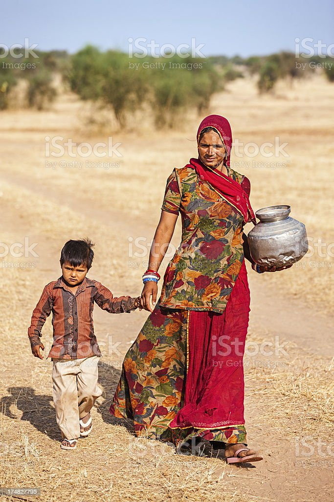 Indian woman carrying water from the well, Rajasthan royalty-free stock photo