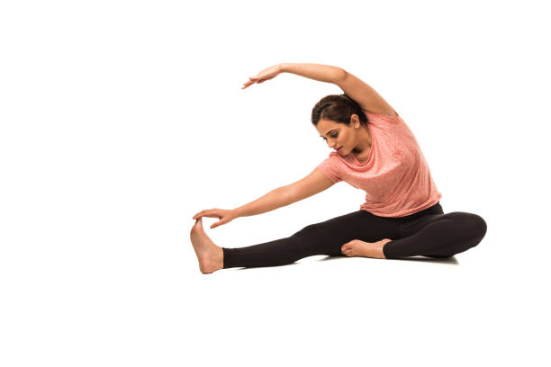 Indian Woman / Girl performing Yoga asana or meditation or dhyan, sitting isolated over white background Indian Woman / Girl performing Yoga asana or meditation or dhyan, sitting isolated over white background yogi stock pictures, royalty-free photos & images