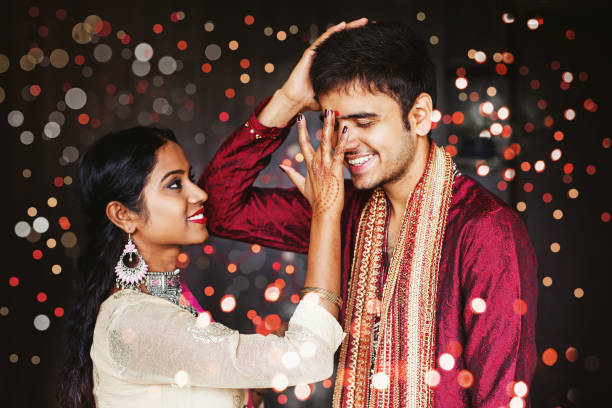 Indian woman giving blessing to her brother stock photo