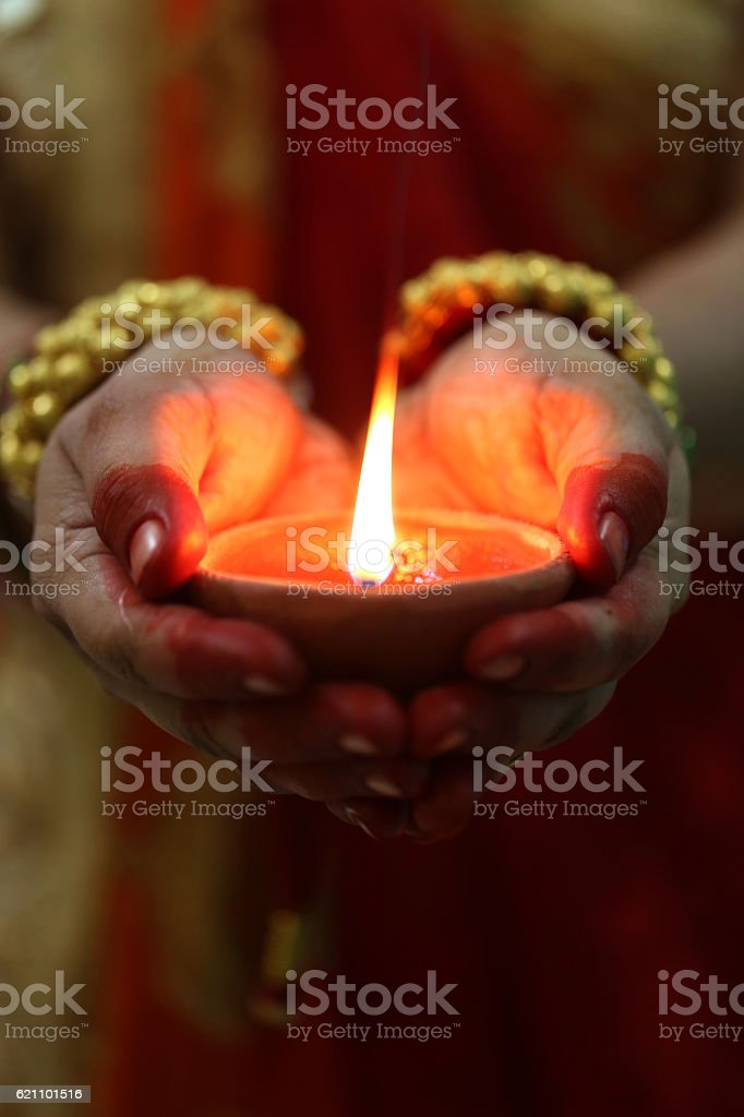 Indian woman holding Diwali oil lamp stock photo