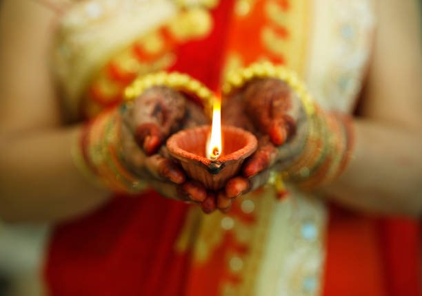 indian woman holding diwali oil lamp - hinduism stock photos and pictures