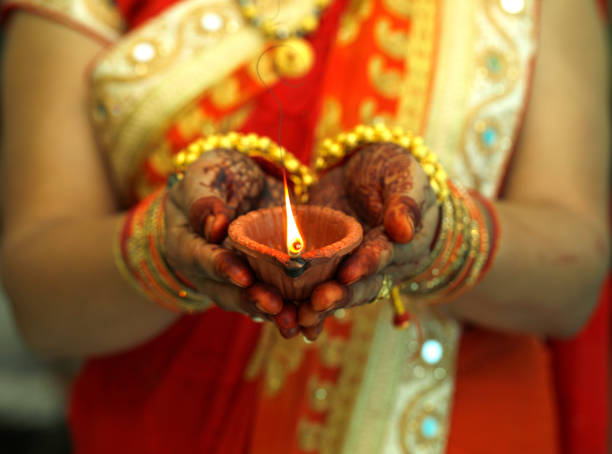 indian woman holding diwali oil lamp - diwali stock pictures, royalty-free photos & images
