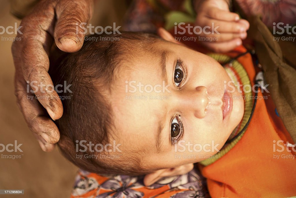 Indian woman holding her child stock photo