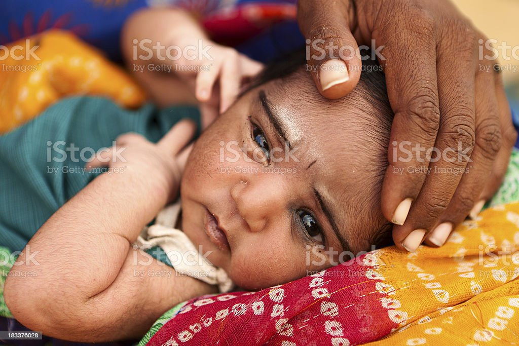 Indian woman holding her child royalty-free stock photo