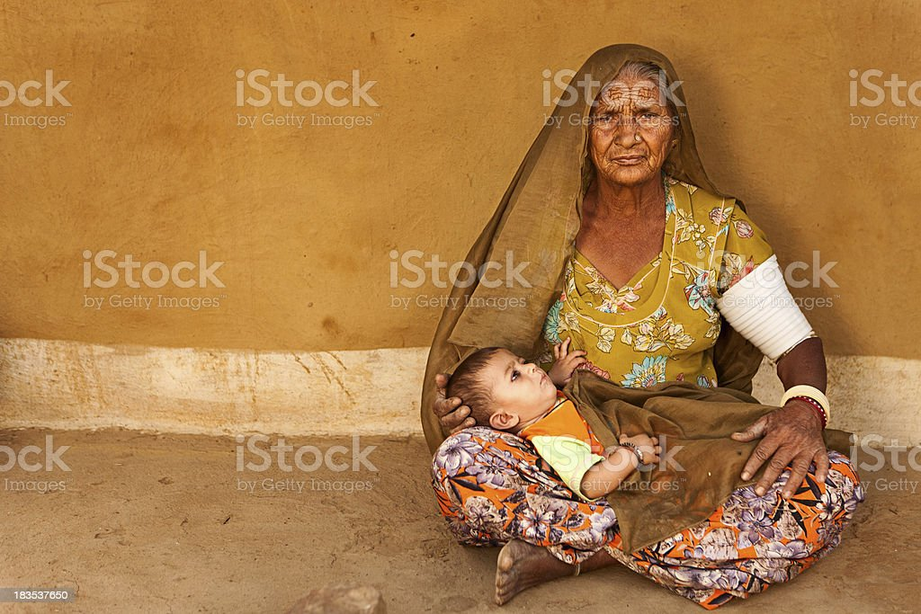Indian woman holding her grandchild royalty-free stock photo