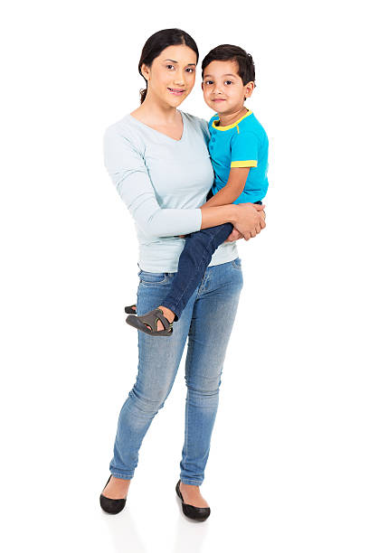 indian woman holding her son stock photo