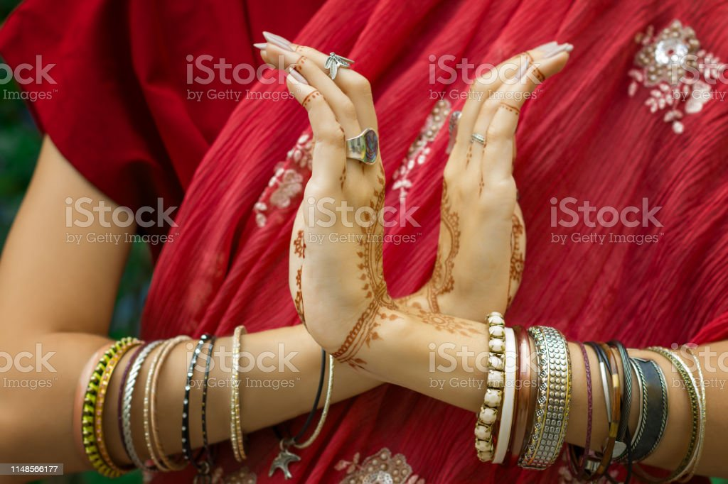 3234a5c48 Indian woman in traditional sari dress with henna tattoo doing hands dance  movement royalty-free