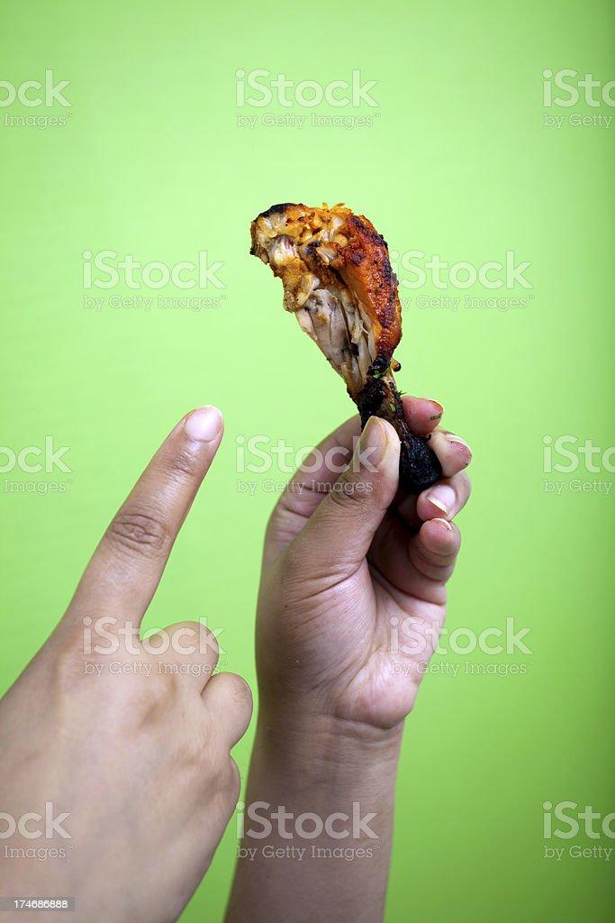 Indian woman pointing towards Tandoori Chicken royalty-free stock photo