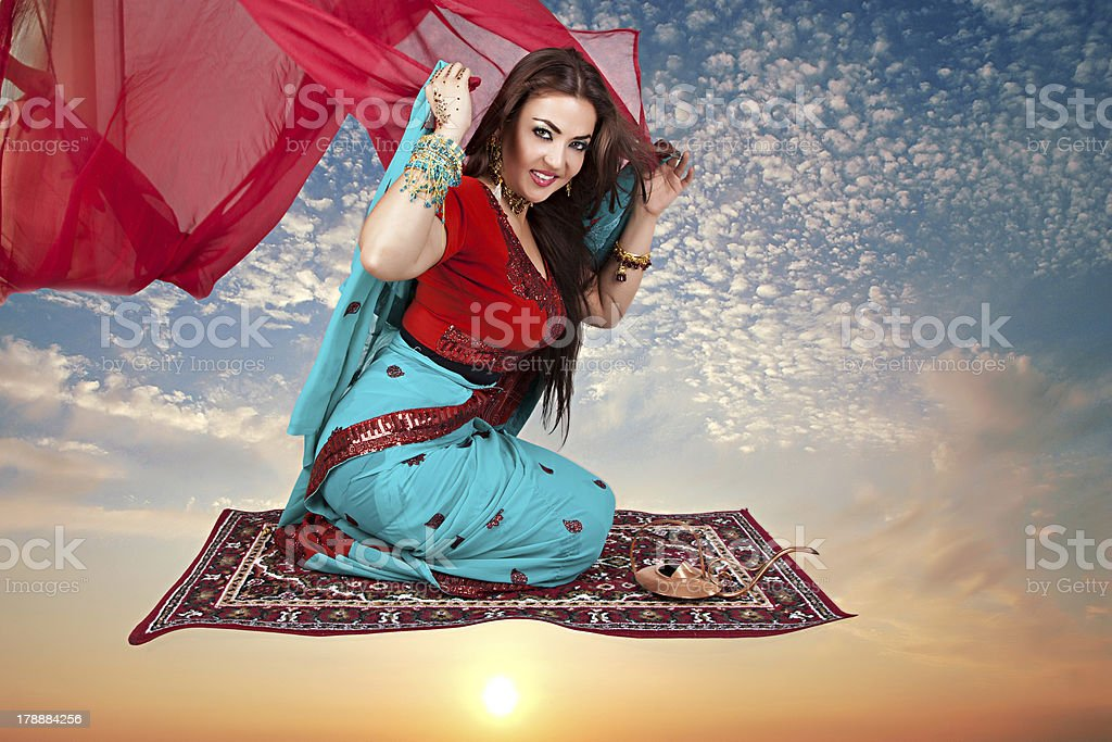 indian woman sitting on a flying carpet royalty-free stock photo