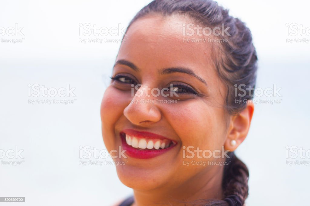 Indian Woman Smiling on Beach stock photo