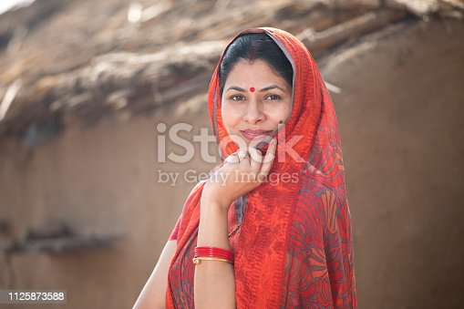 Indian woman standing at village