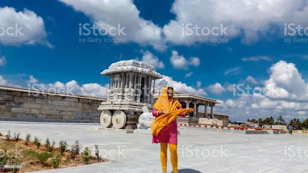 Indian woman standing in front of temple royalty-free stock photo