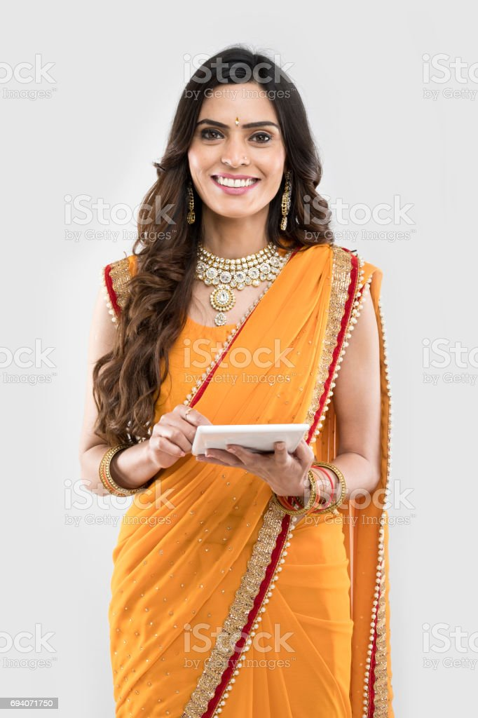 Indian woman using digital tablet stock photo