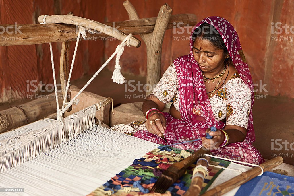 Indian woman weaving textiles (durry). Salawas village. Rajasthan. stock photo