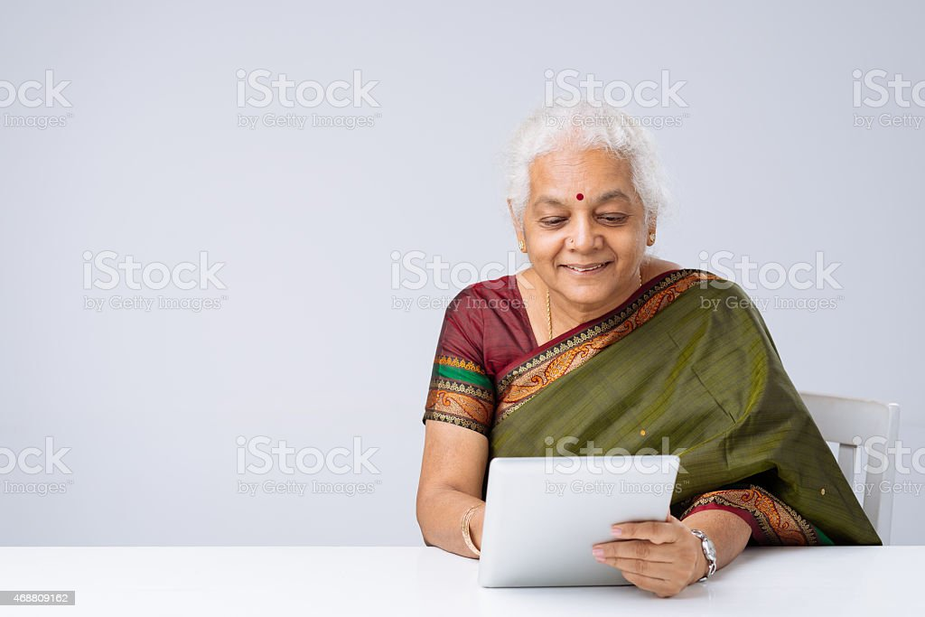 Indian woman with digital tablet stock photo