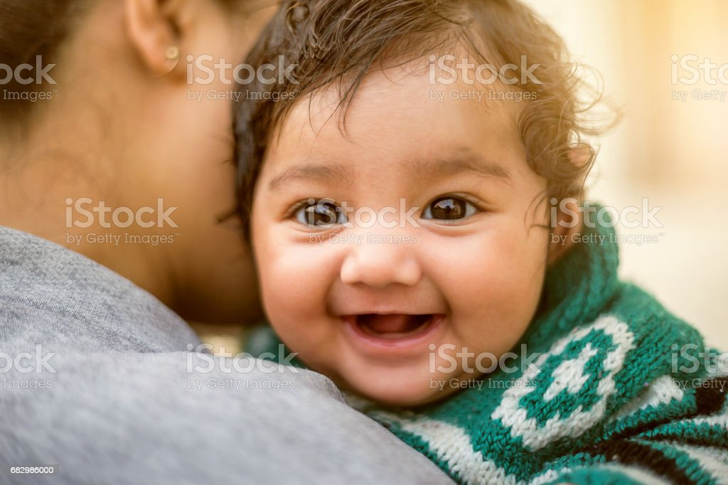 Indian woman with her newborn daughter stock photo