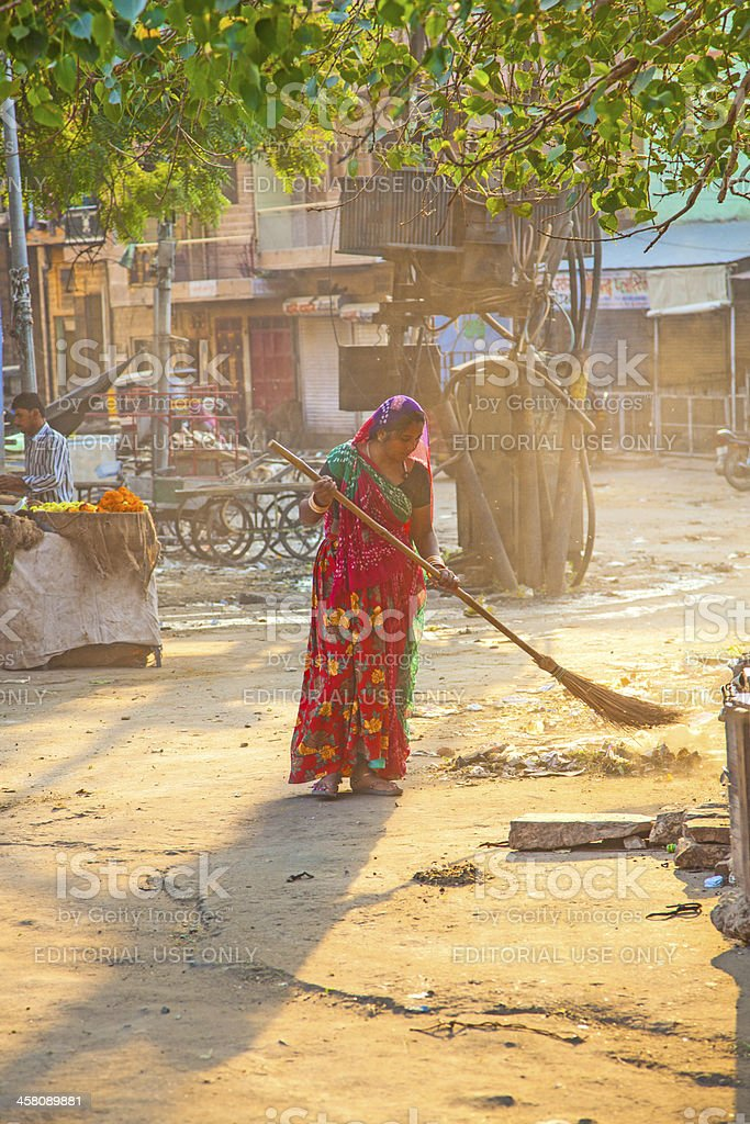 Indian Woman Working As A Road Sweeper Stock Photo