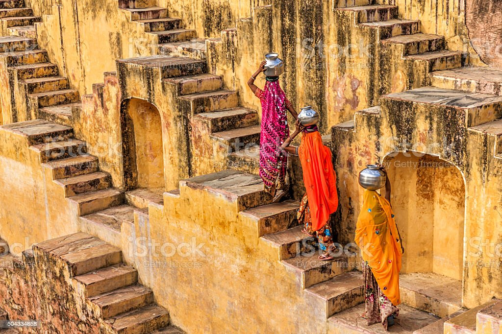 Indian women carrying water from stepwell near Jaipur stock photo