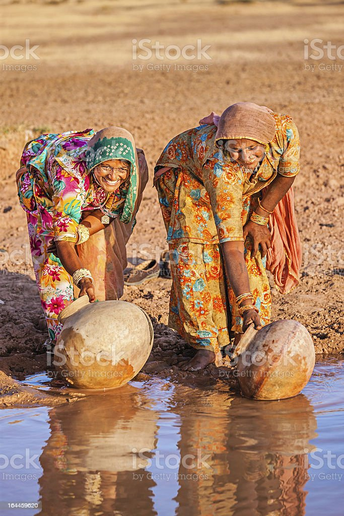 Indian women collecting water, Rajasthan royalty-free stock photo