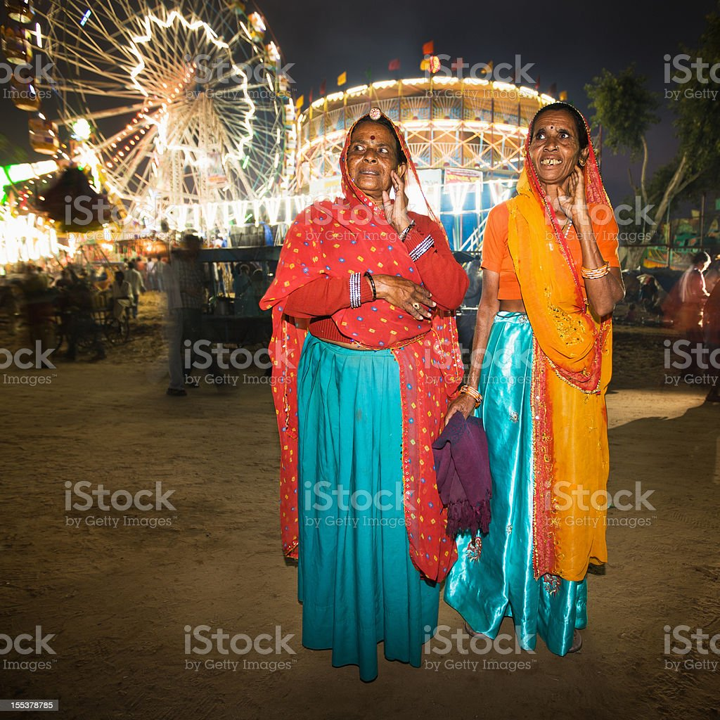 Indian Women Experiencing Pushkar Camel Fair royalty-free stock photo