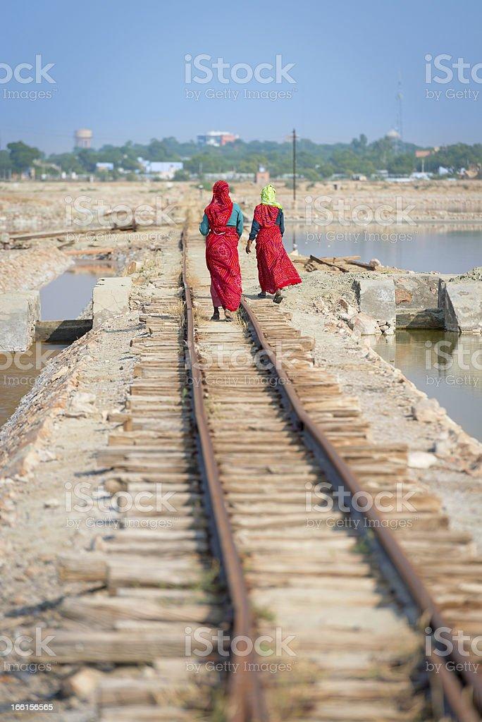 Indian women in sari on railway royalty-free stock photo