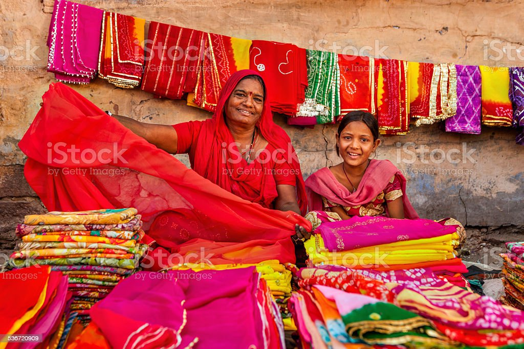 Indian women selling colorful fabrics stock photo